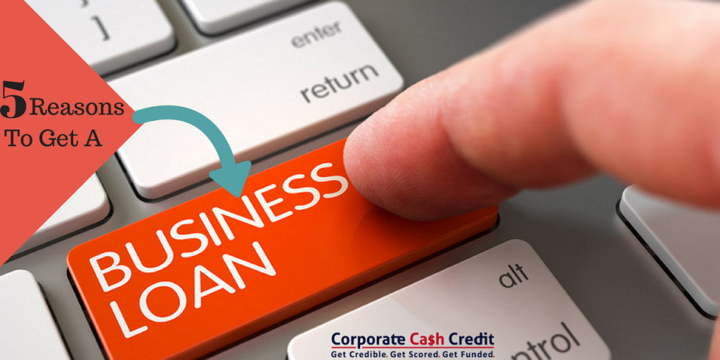 A finger pointing on the button of a business loan which represents 5 reasons to get business loans